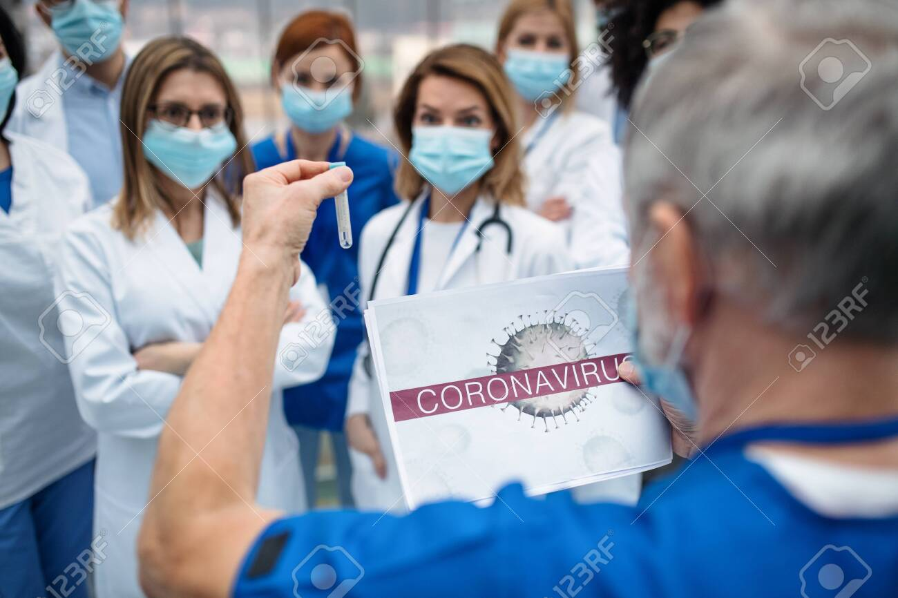 Group of doctors talking about corona virus on conference. - 139930735