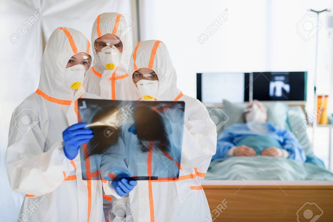 Medical team looking after infected patients in hospital, coronavirus concept. - 142017895
