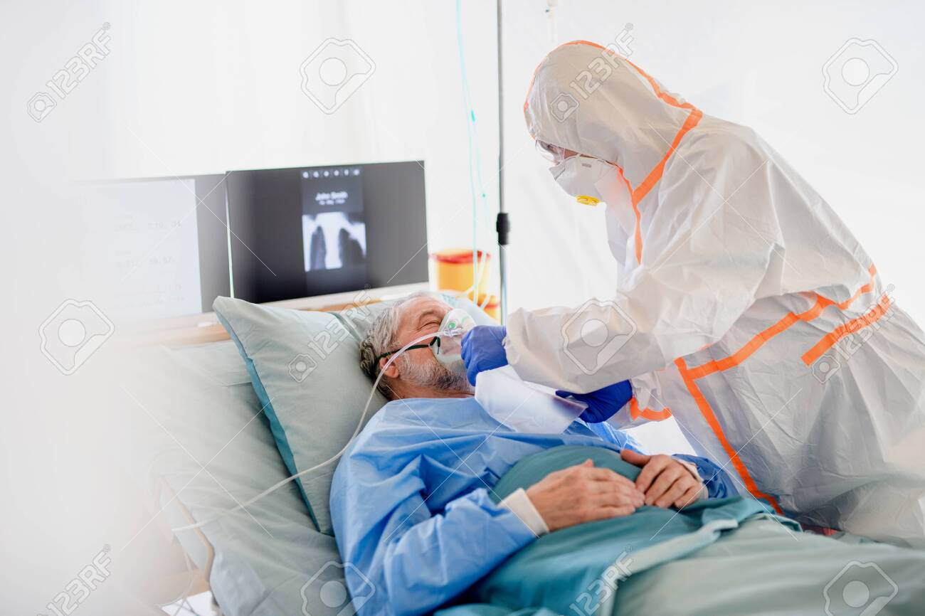 Infected patient in quarantine lying in bed in hospital, coronavirus concept. - 143699611