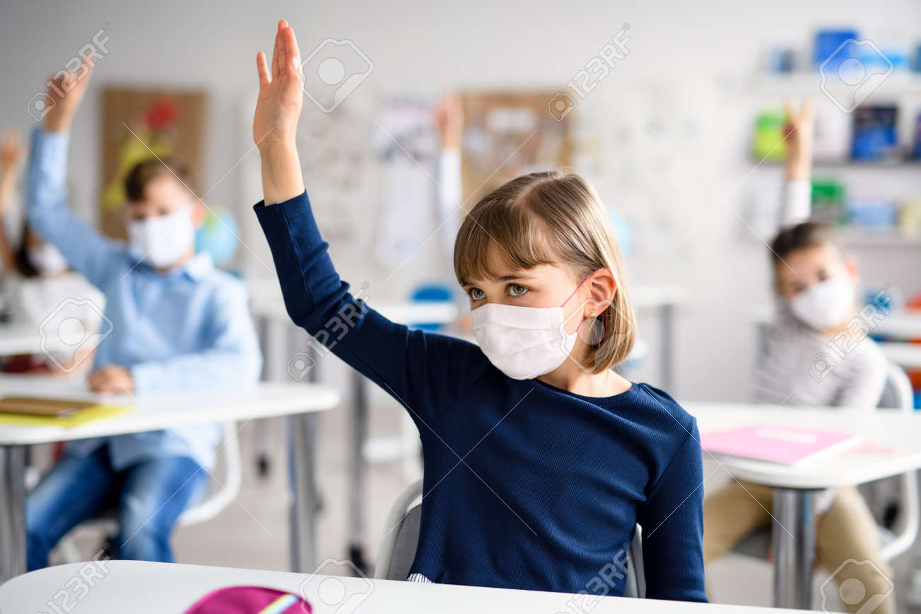 Child with face mask back at school after covid-19 quarantine and lockdown. - 148162914