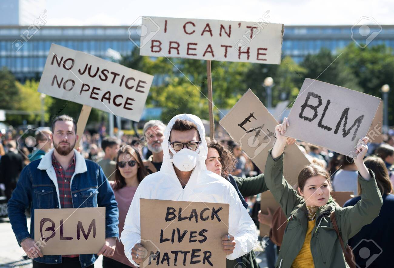 Black lives matters protesters holding signs and marching outdoors in streets. - 149912584