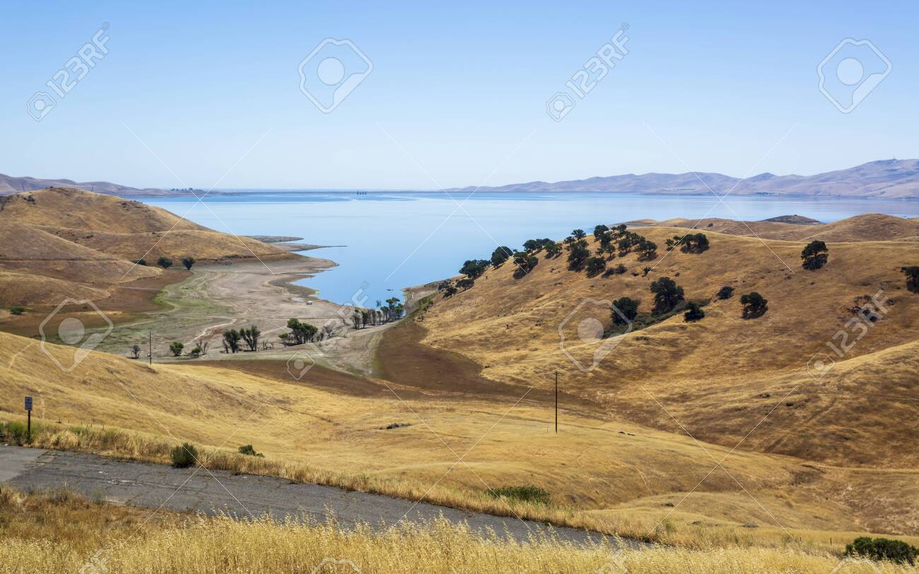 Driving Through The Golden Hills Of California The San Luis Reservoir Stock Photo Picture And Royalty Free Image Image 127599534
