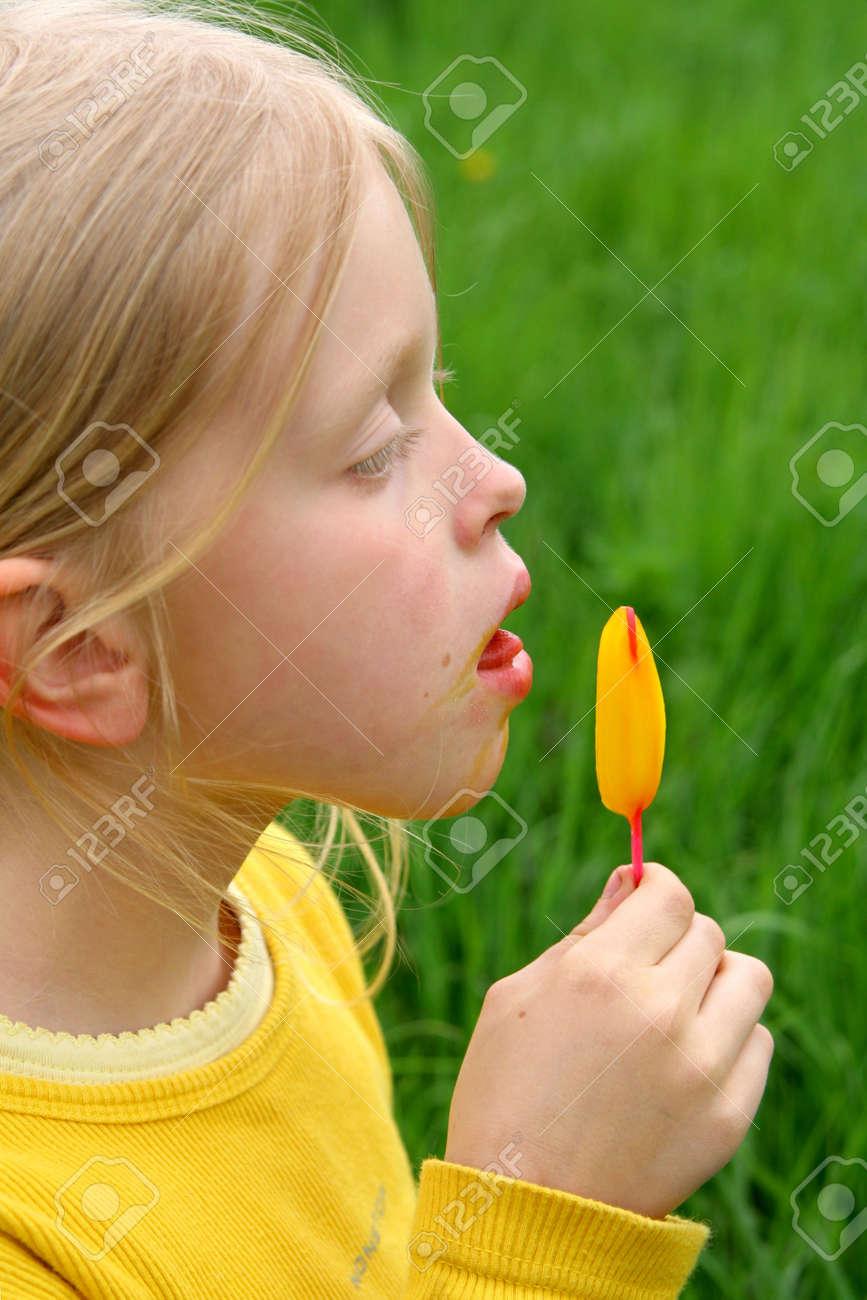 Licking yellow ice-cream Stock Photo - 514442