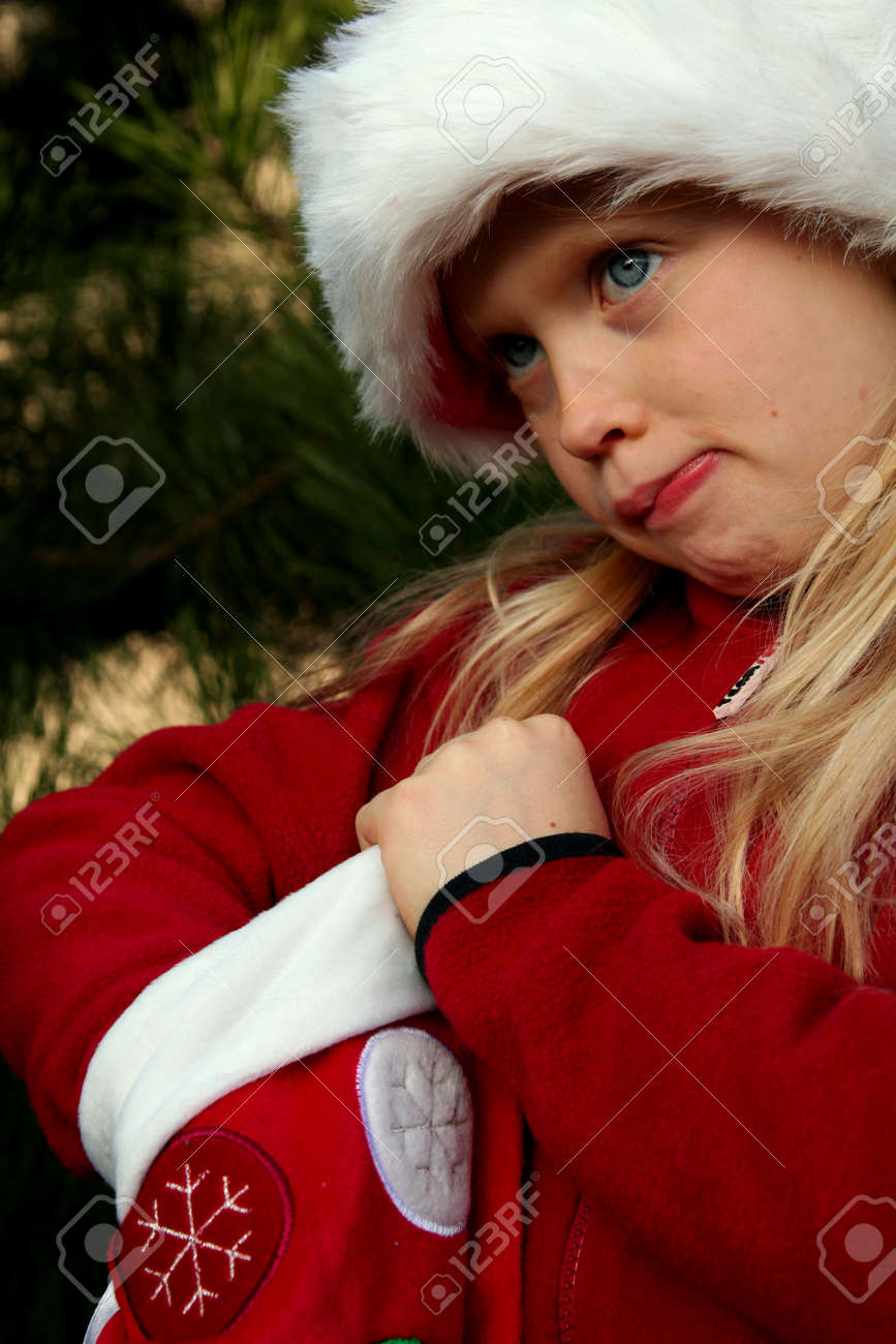 Portrait of a little girl wearing Santa Claus hat with christmas stocking Stock Photo - 675775