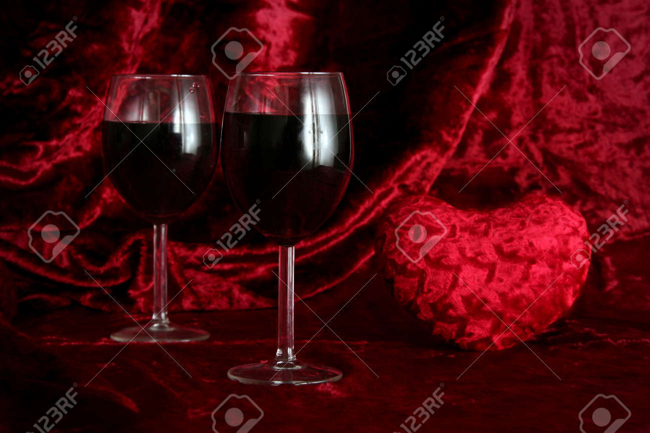 Glass of wine on a dark red background Stock Photo - 703460