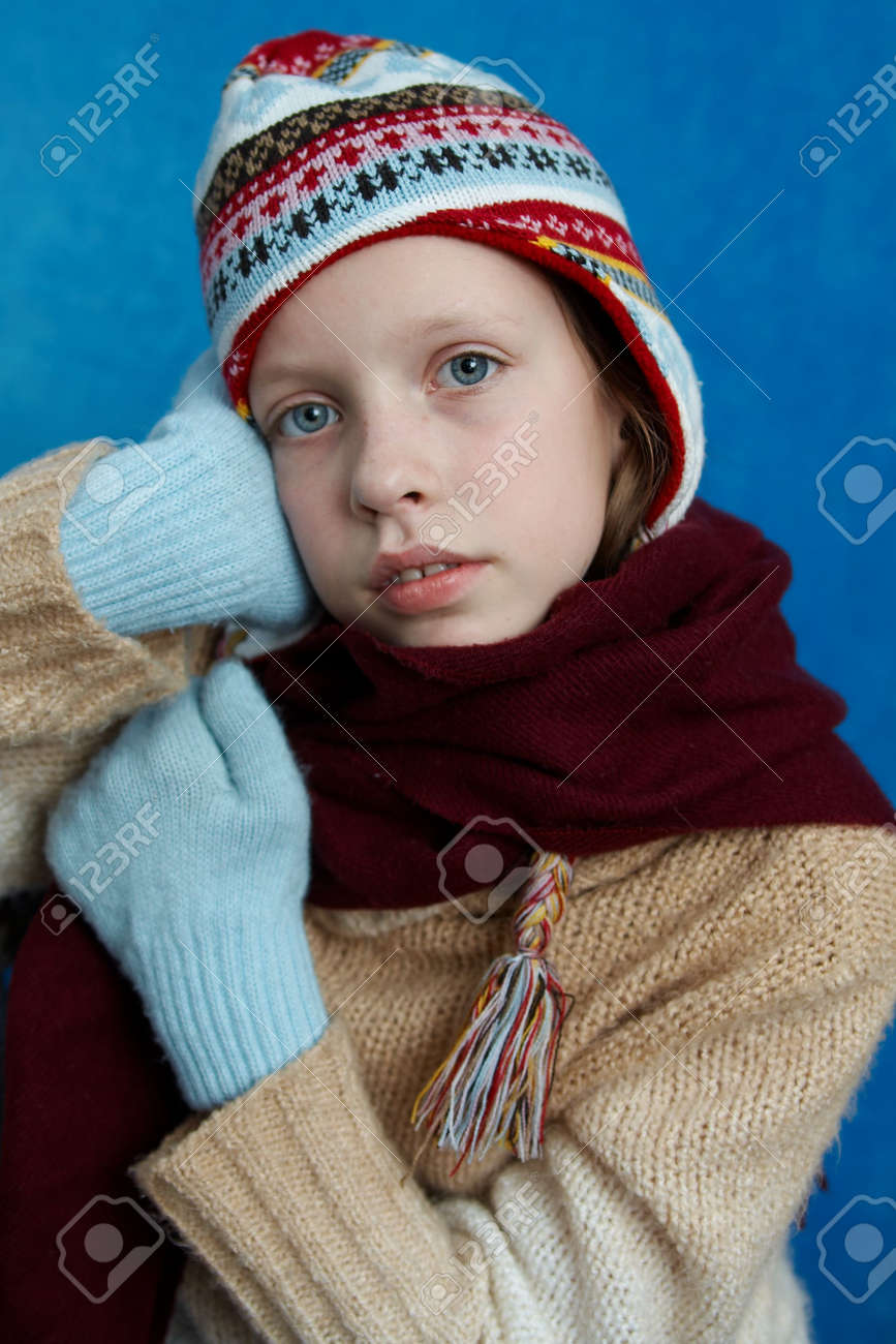 bff98342c879 Stock Photo - Young girl wearing woolen cap