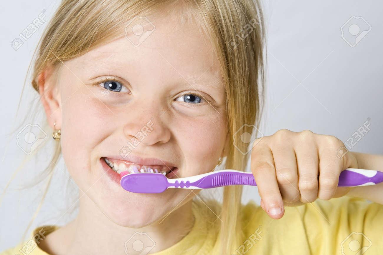 Little girl wearing colorful t-shirts brushing teeth Stock Photo - 3437323