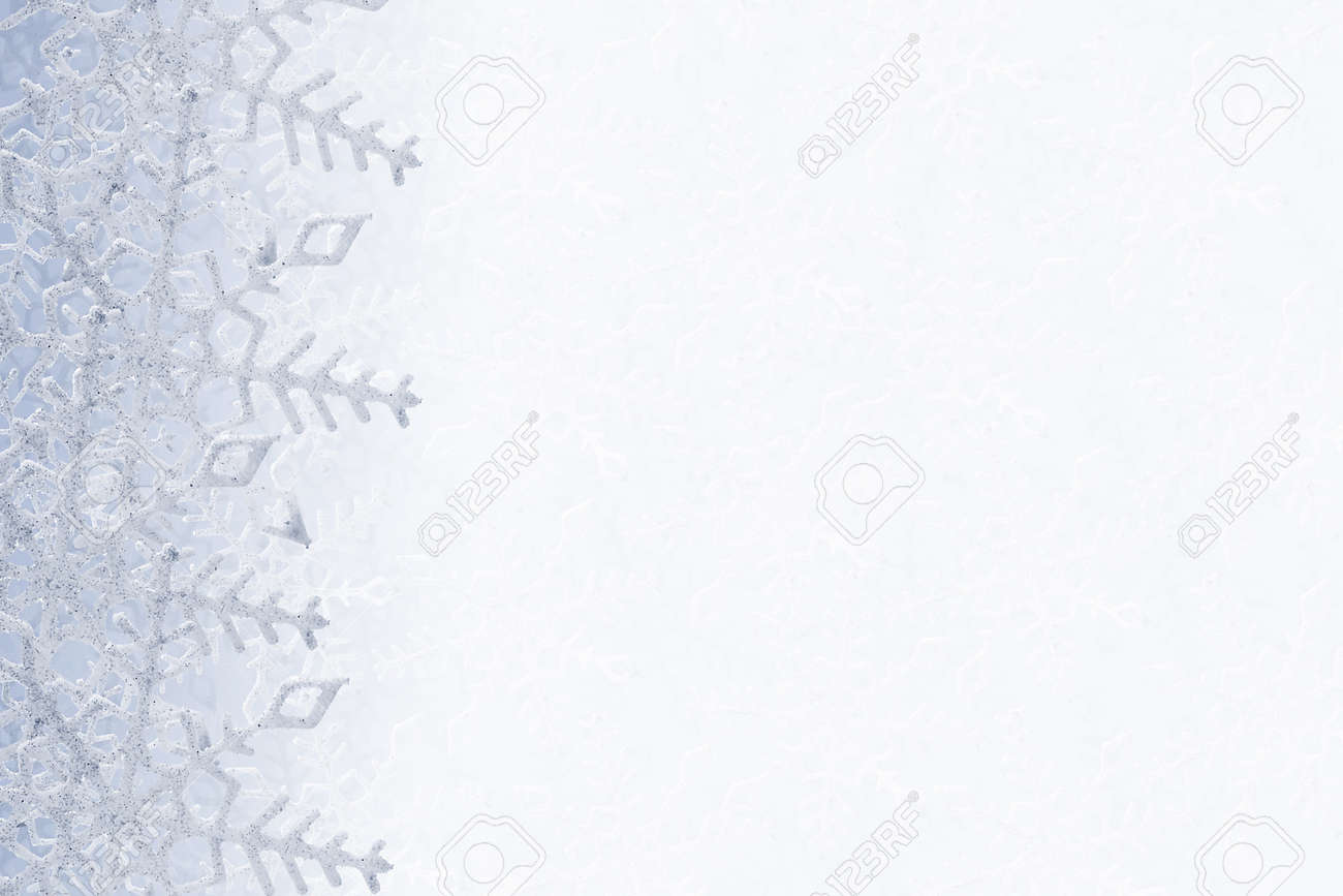 Blue and white snowflakes on a blue and white background Stock Photo - 16054647