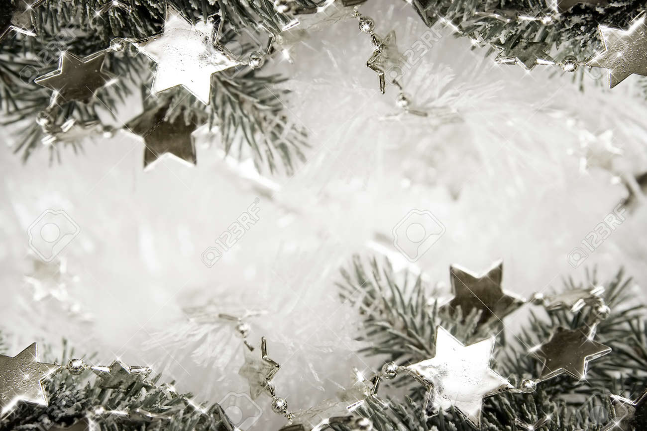 Silver sparkling stars on a white glistening background Stock Photo - 16451404