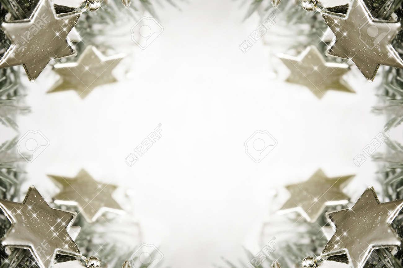 Silver sparkling stars on a white glistening background Stock Photo - 16676586