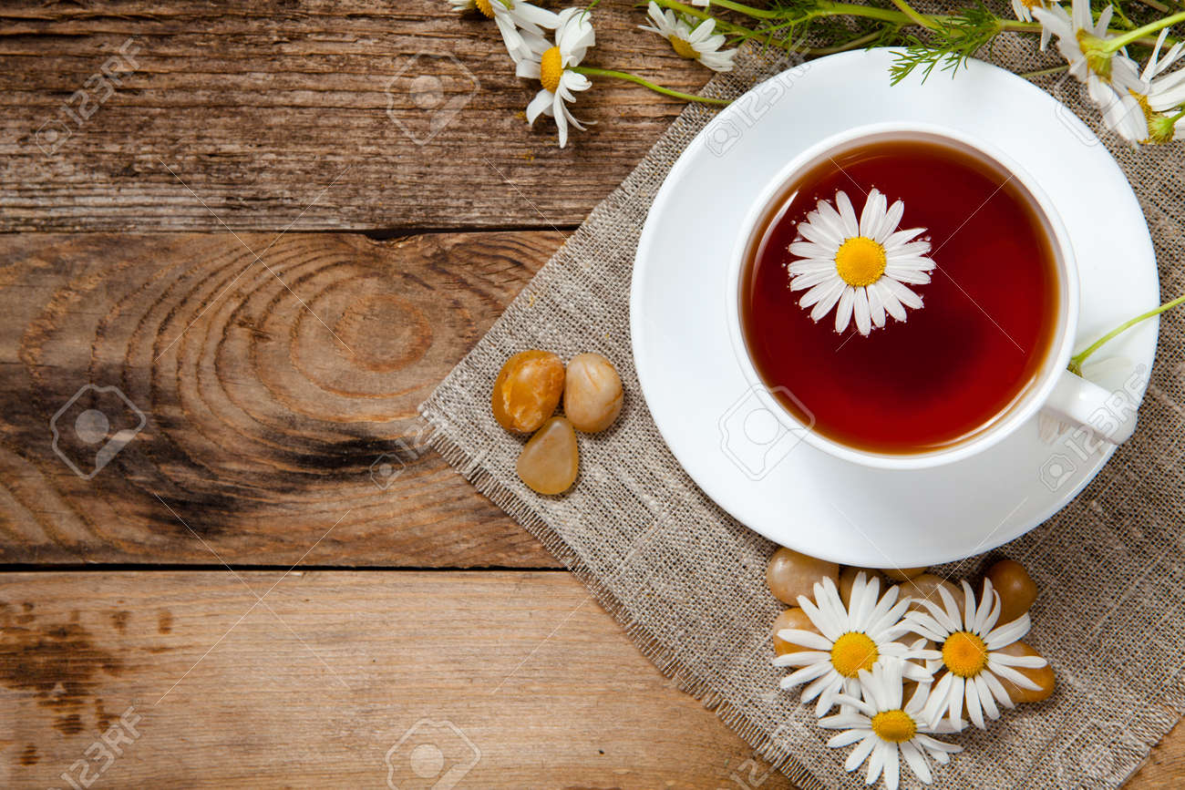 herbal tea with chamomile on old wooden table. Top view. - 29489811