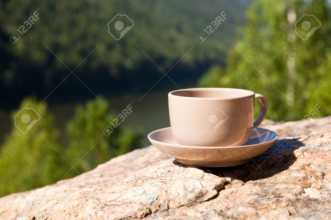 Cup on big stone over nature background. With place for text. - 31675784