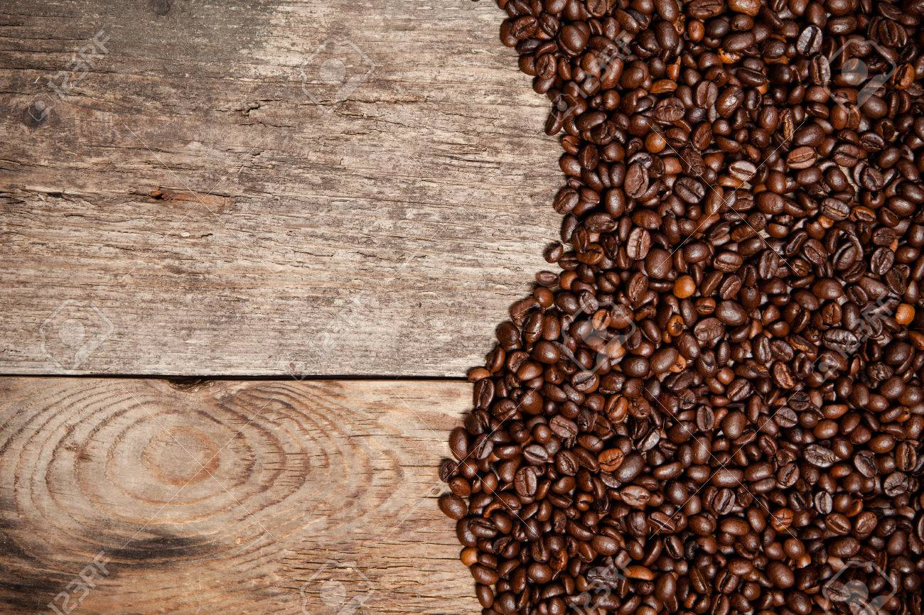 Old wooden table top - Coffee Beans On Old Wood Table Top View Stock Photo 33012275