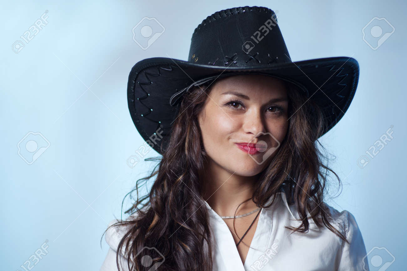 Smiling woman with cowboy hat Stock Photo - 36670043 e090c8ad814