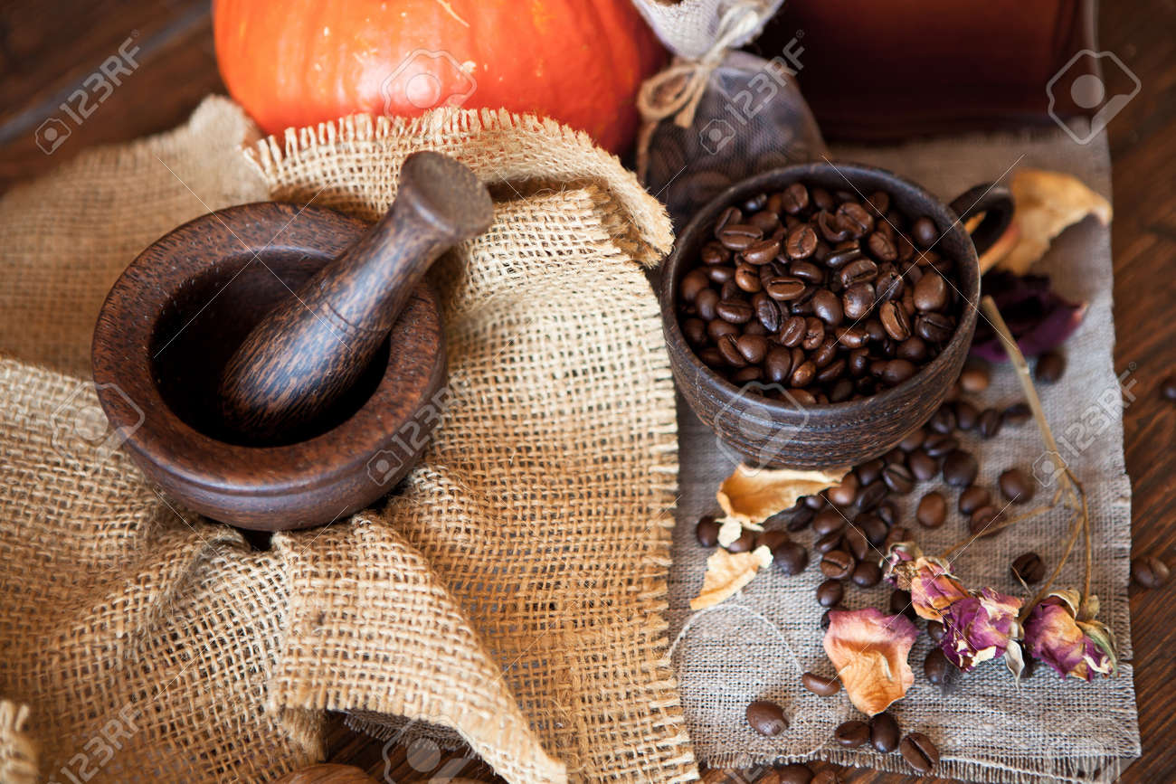 Cup of coffee with coffee beans and coffee grinder  Still life