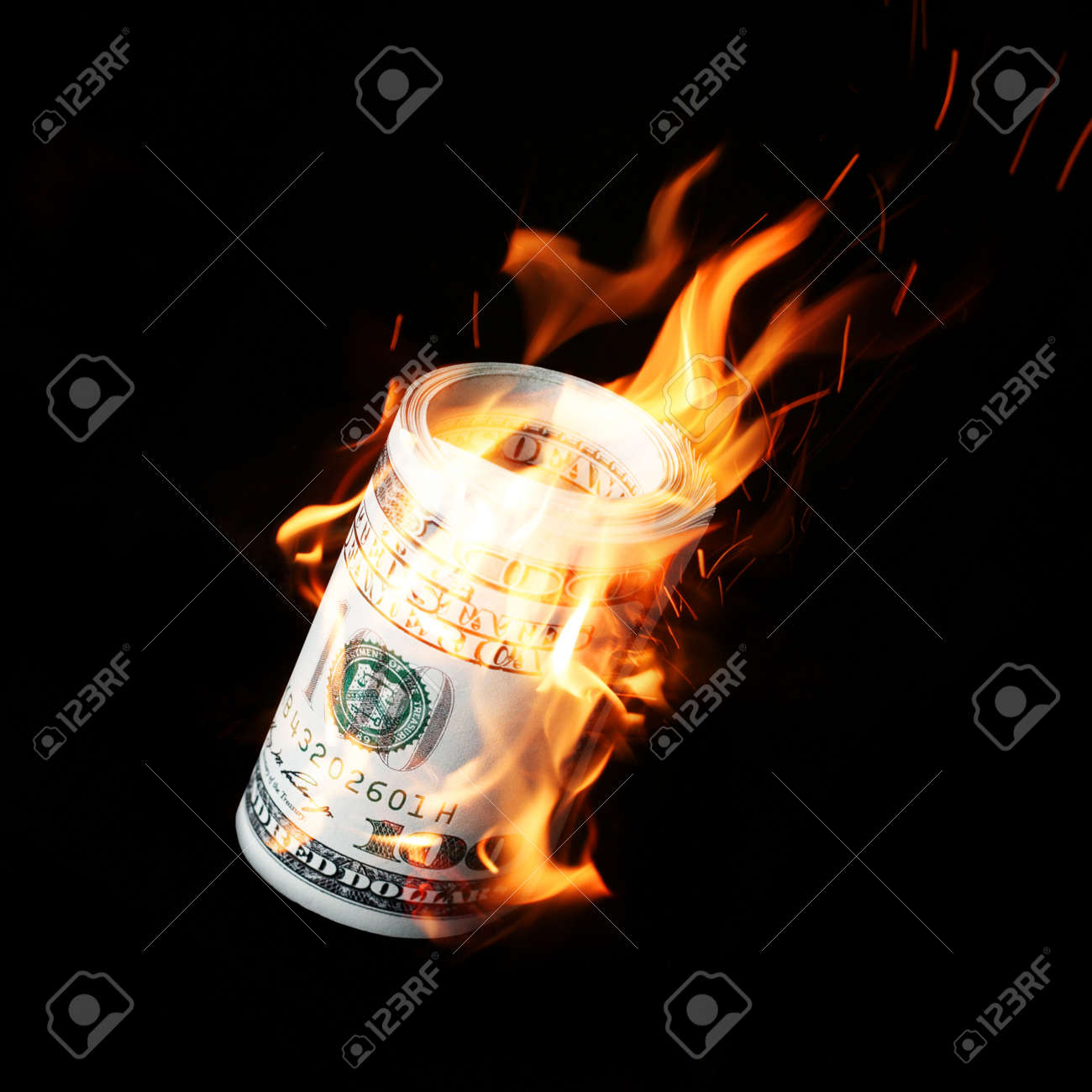 Burning one hundred dollar bills rolled black background - 60408088