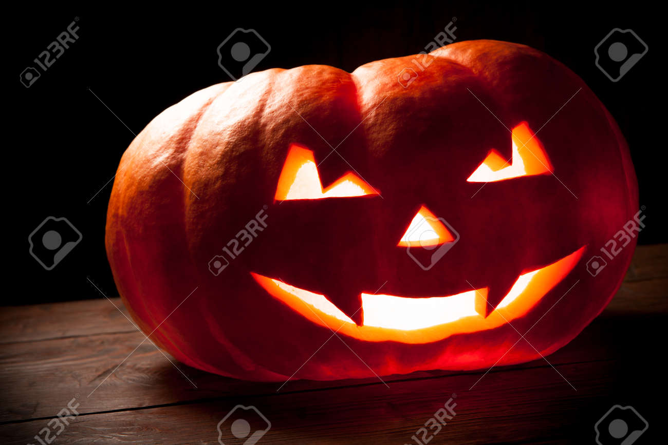 scary halloween pumpkin on a old wooden background scary glowing rh 123rf com