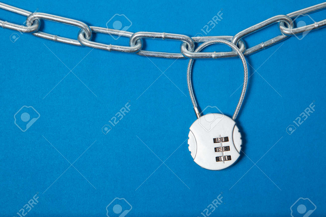 Cipher padlock on chain on blue background. Security concept. - 159093424