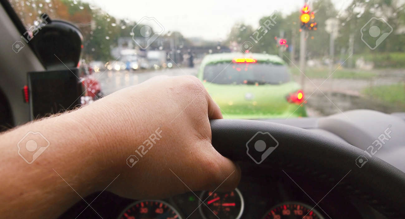 Closeup of hand holding steering wheel during driving a car in