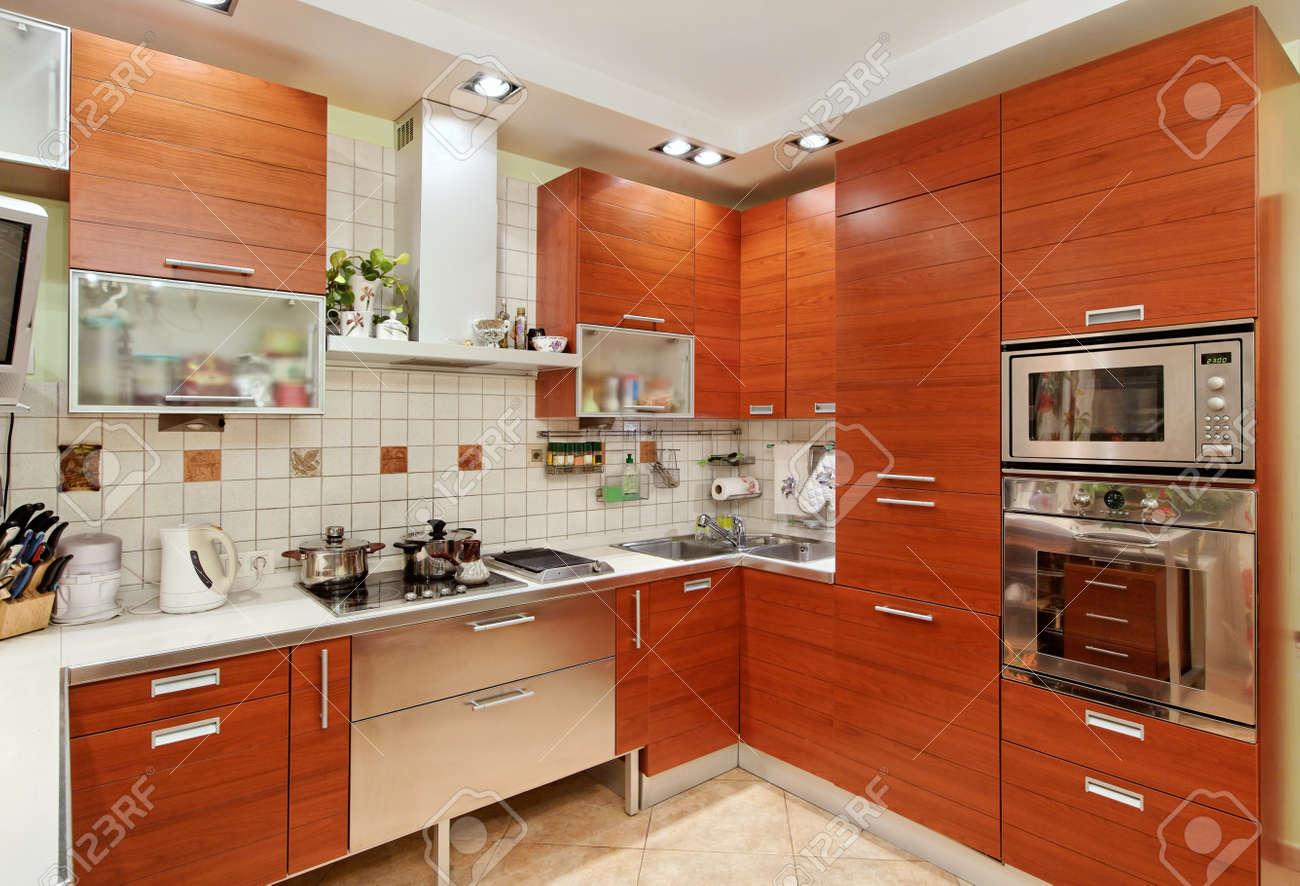 Uncategorized Wooden Furniture For Kitchen kitchen interior with wooden furniture and many utensils in warm tones on wide angle view stock