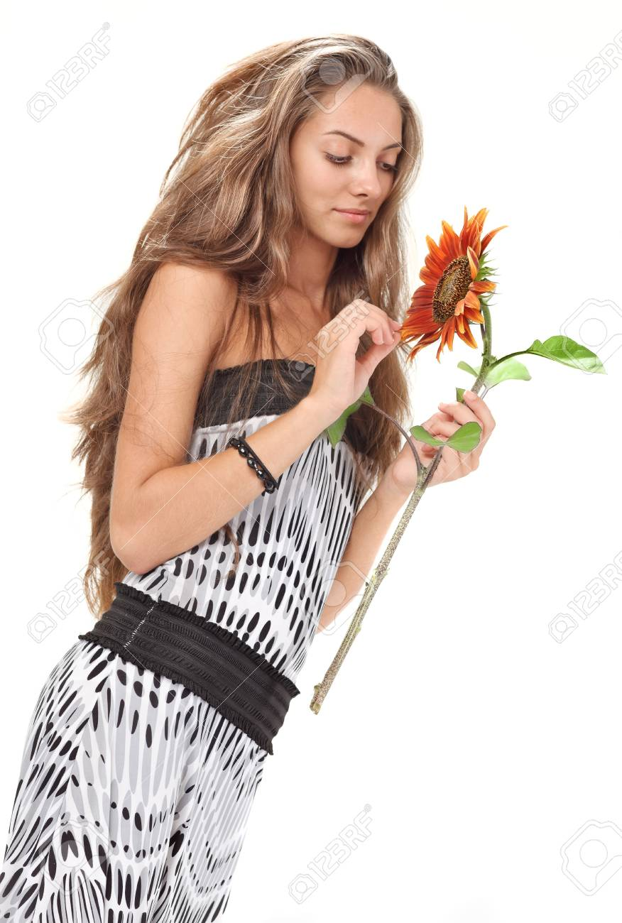 Young beautiful girl with long hairs holding sunflower on white Stock Photo - 7907756