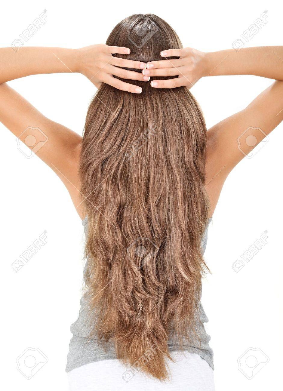 Brunette lady holding long hairs, view from back side isolated on white Stock Photo - 7907764