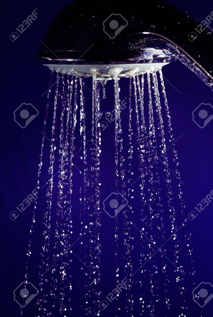 Hand shower douche with stopped motion water drops on deep blue Stock Photo - 8324732