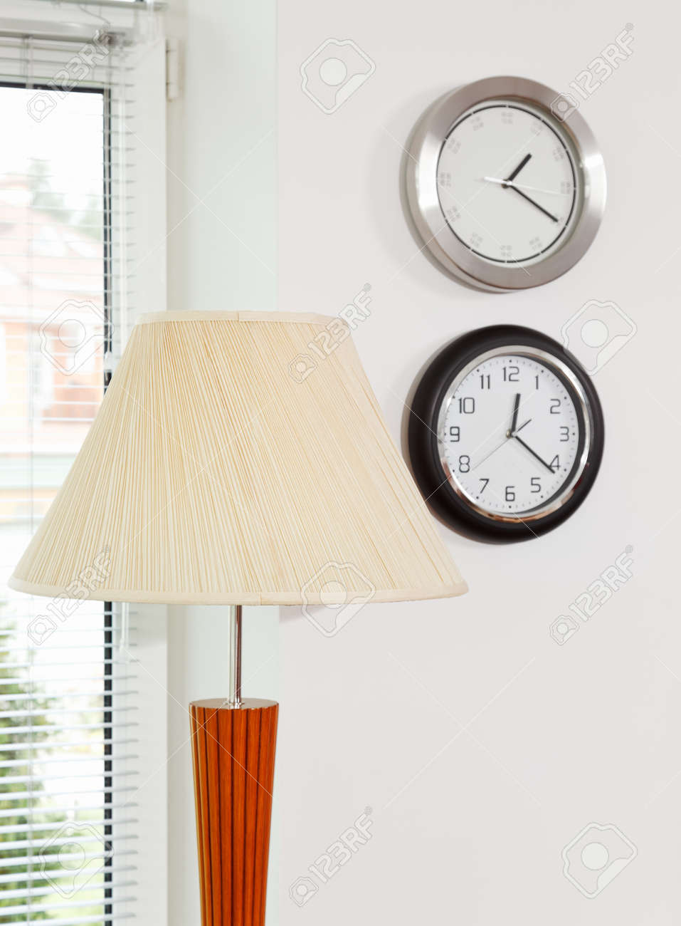 Part of modern minimalism style interior with lamp shade and clocks Stock Photo - 8547279