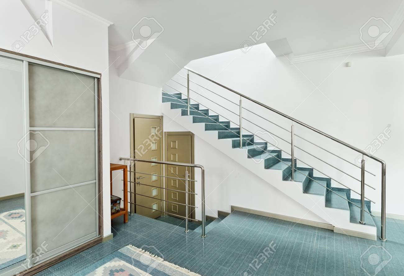 Modern hall with metal staircase interior in minimalism style Stock Photo - 8547639