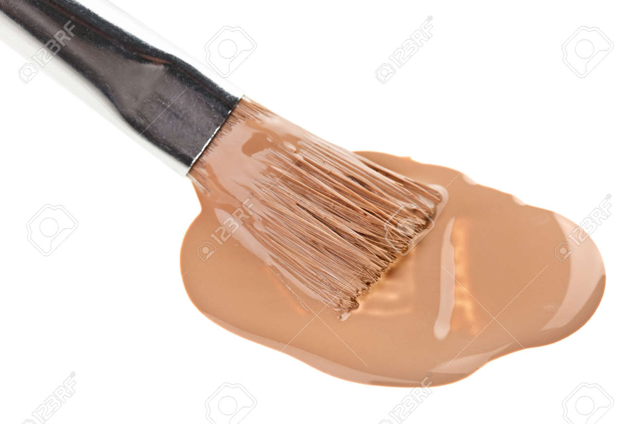 Beige liquid foundation makeup stroke with brush, isolated on white Stock Photo - 9452514