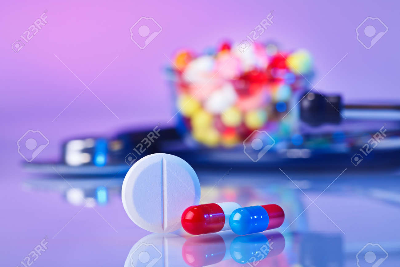 Pills and tablets macro still life on violet, medical therapeutic concept Stock Photo - 12838504