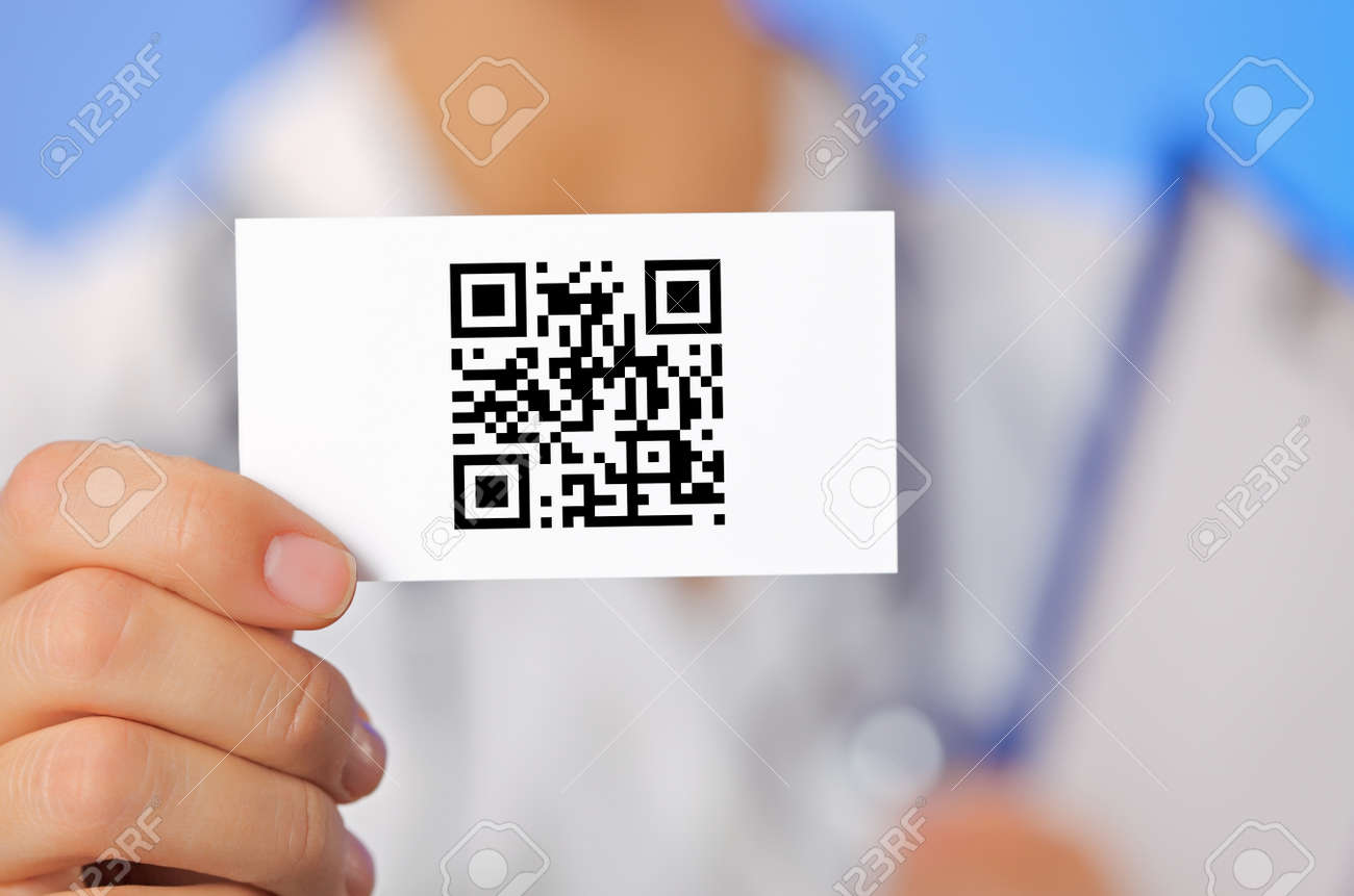Doctor Holding Business Card With Health Care QR Code On Blue ...