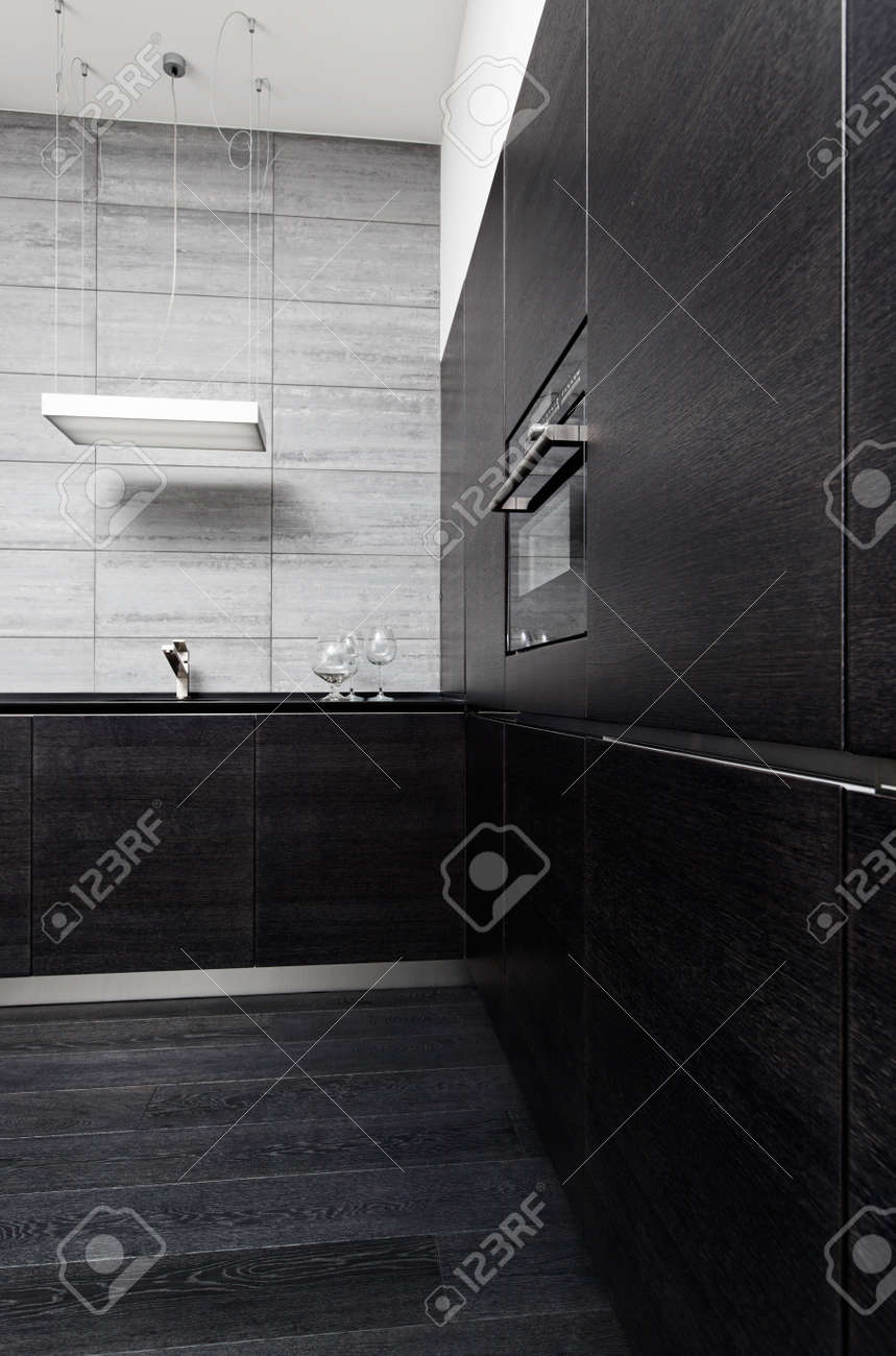 Part of black hardwood kitchen in modern style with build-in utensils Stock Photo - 14883186