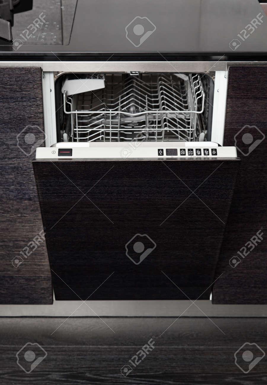 Open dish washer machine on black hardwood kitchen Stock Photo - 14883164