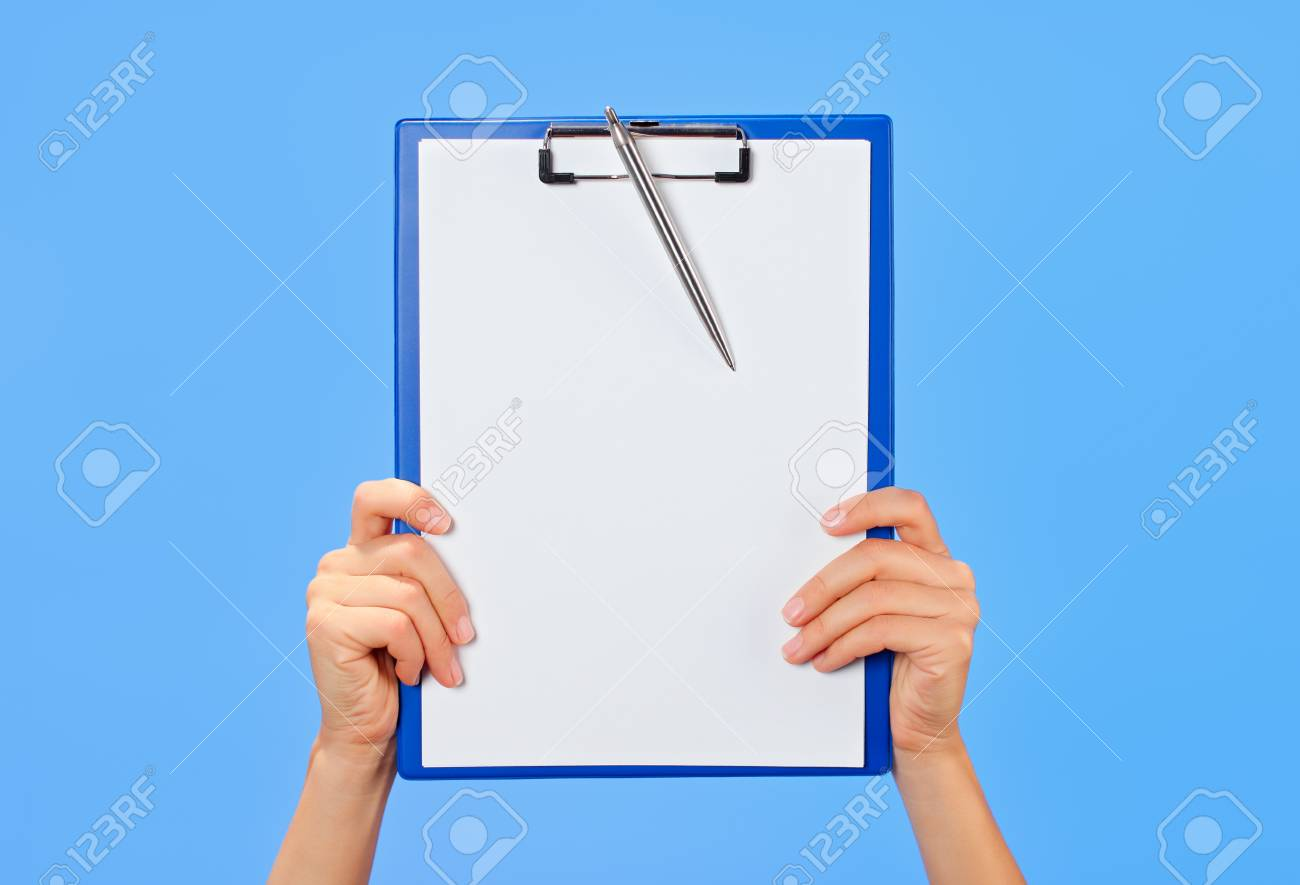 Clipboard in female hands on blue background Stock Photo - 15213809