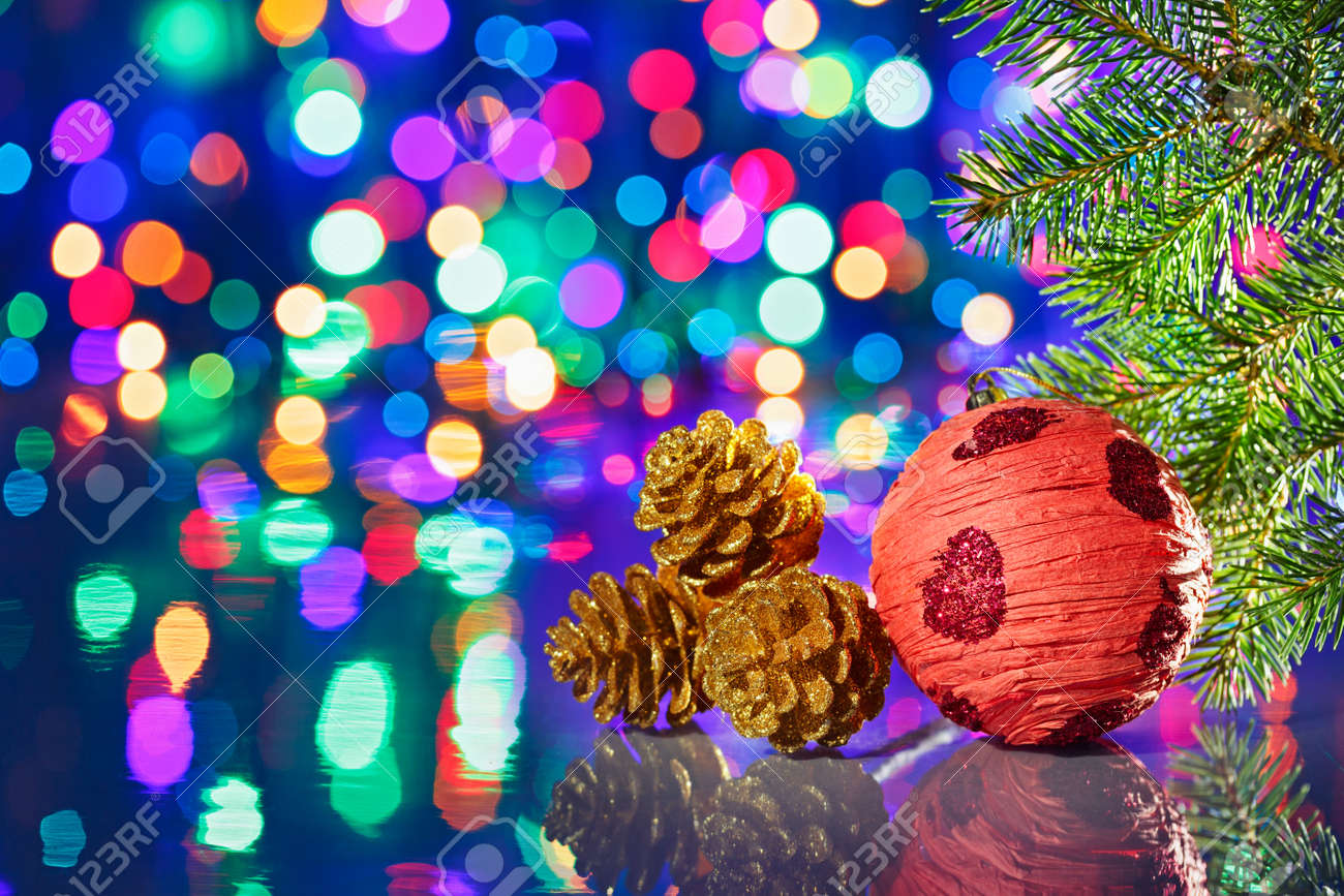 Red Christmas decorations ball with spruce and cones on bokeh background Stock Photo - 15586922