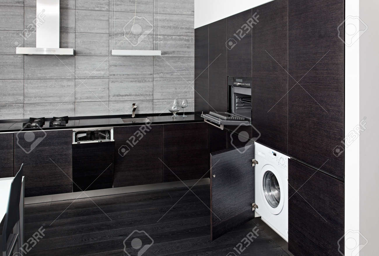 Part of black hardwood kitchen with build-in domestic technique Stock Photo - 15766966