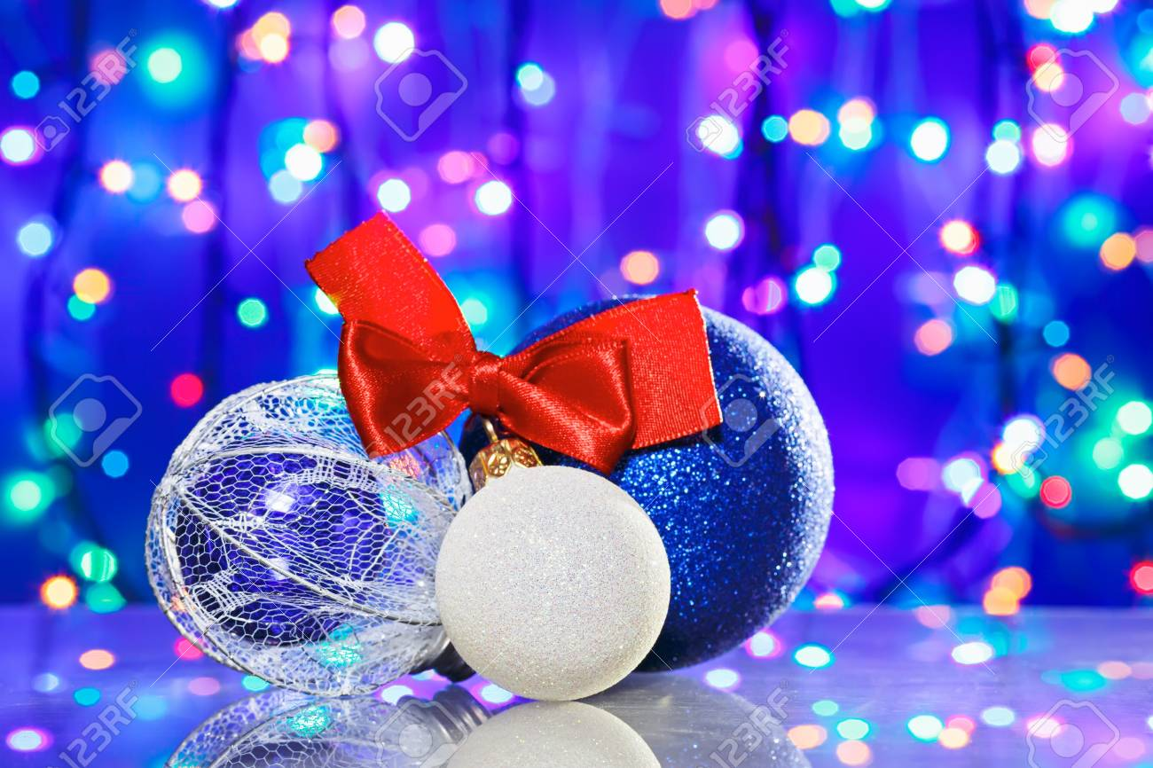 New Year decoration ball toys with red ribbon bow on circles bokeh background Stock Photo - 16434310