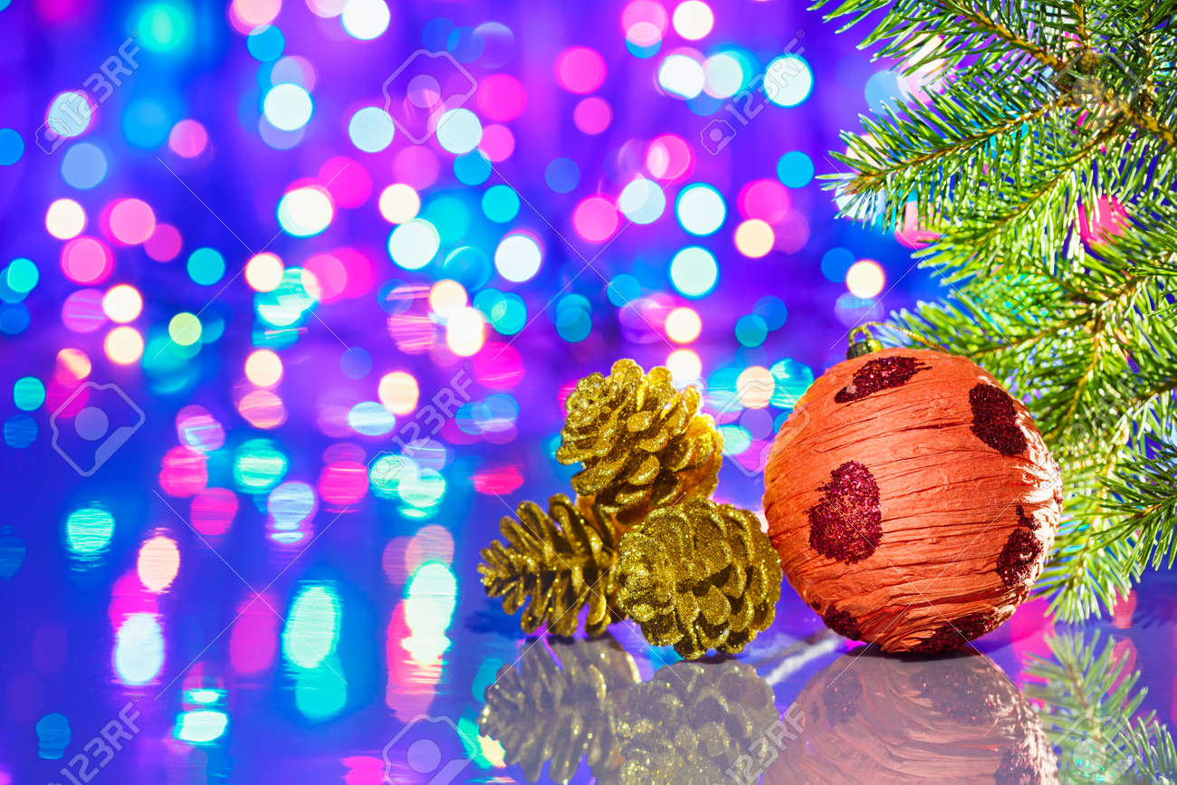 Christmas tree decorations ball with spruce and cones on bokeh background Stock Photo - 16434156