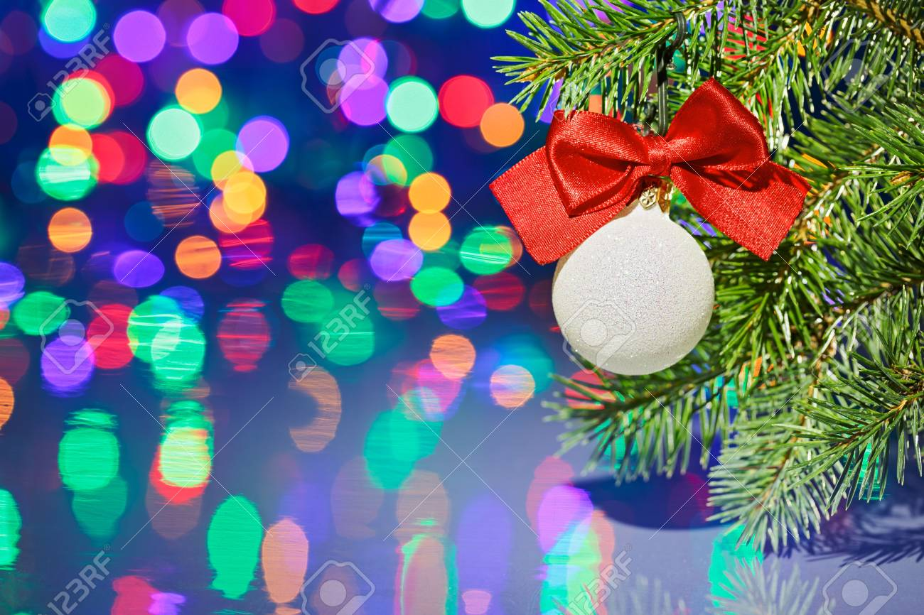 Christmas tree decoration ball with spruce branch on bokeh background Stock Photo - 16434152
