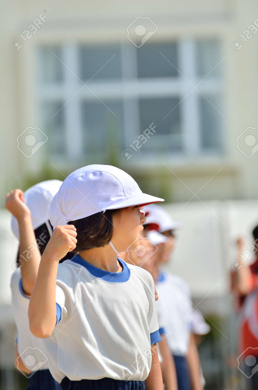Girl cheering (Sports day) - 64799973