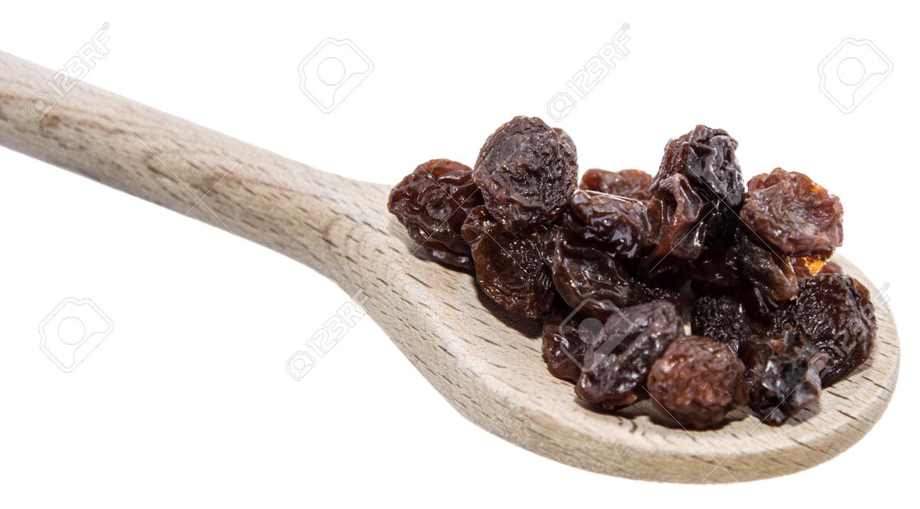 Raisins on a wooden spoon against white background Stock Photo - 16067527