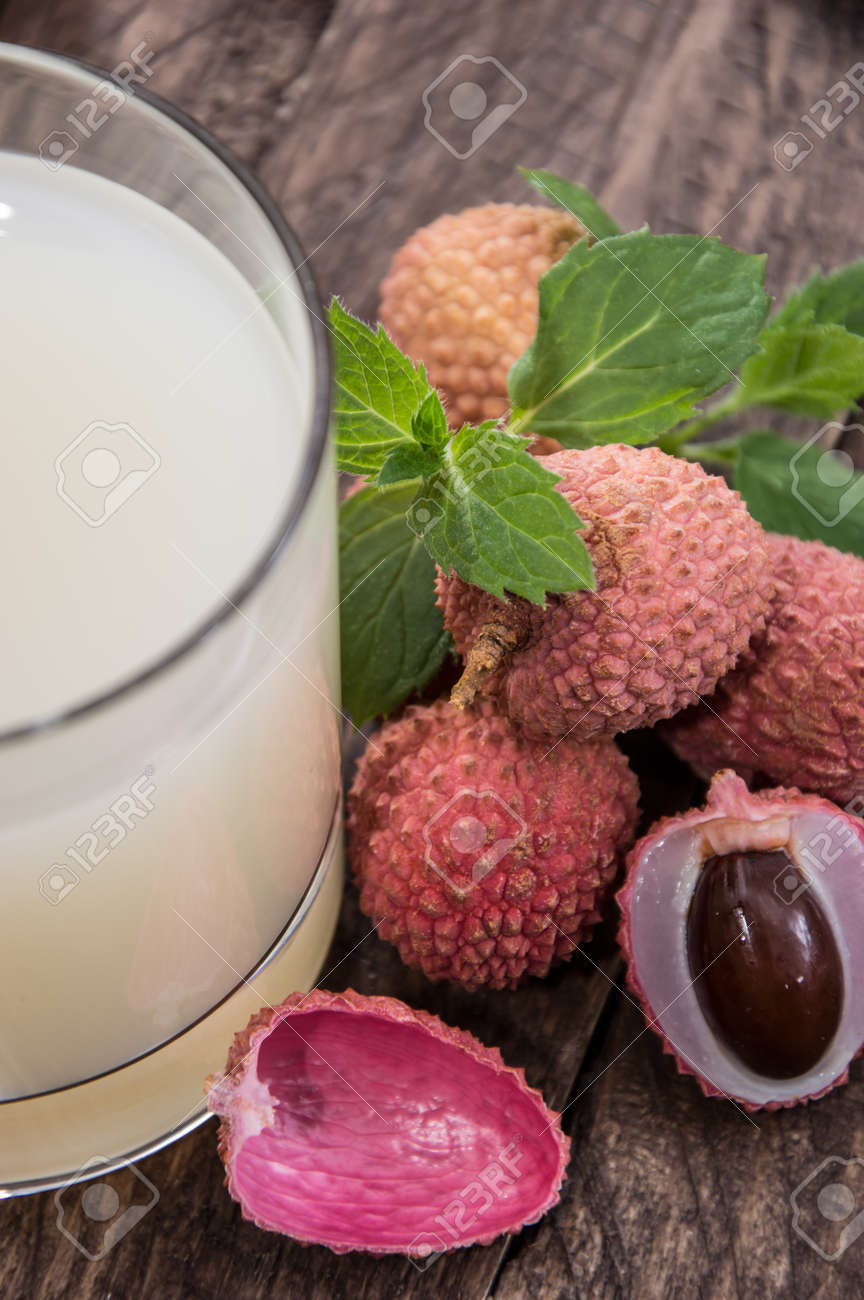 Lychee Juice with fresh fruits on wooden background Stock Photo - 17072150