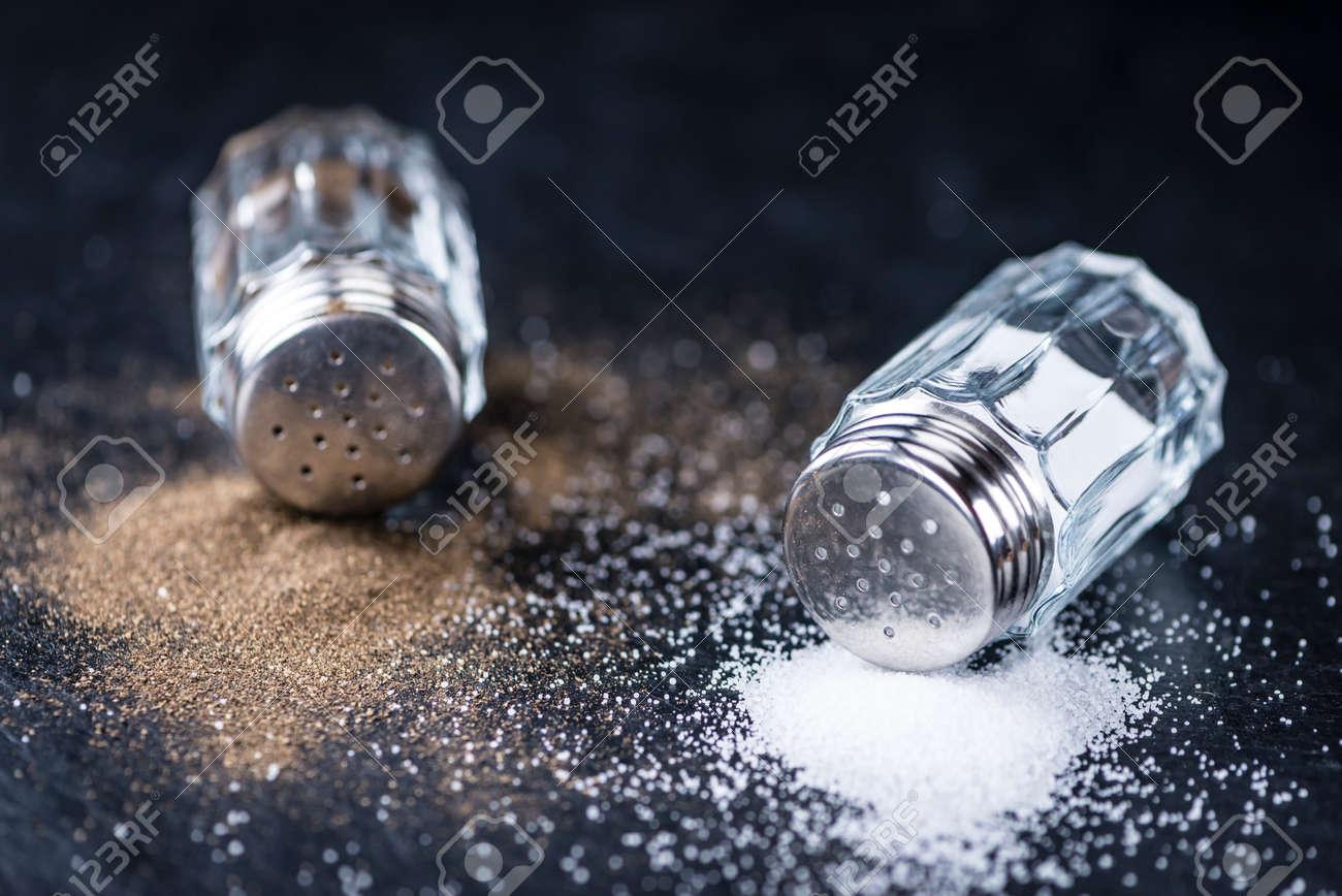 Salt and Pepper Shakers on a slate slab (selective focus; close-up shot) - 54800479
