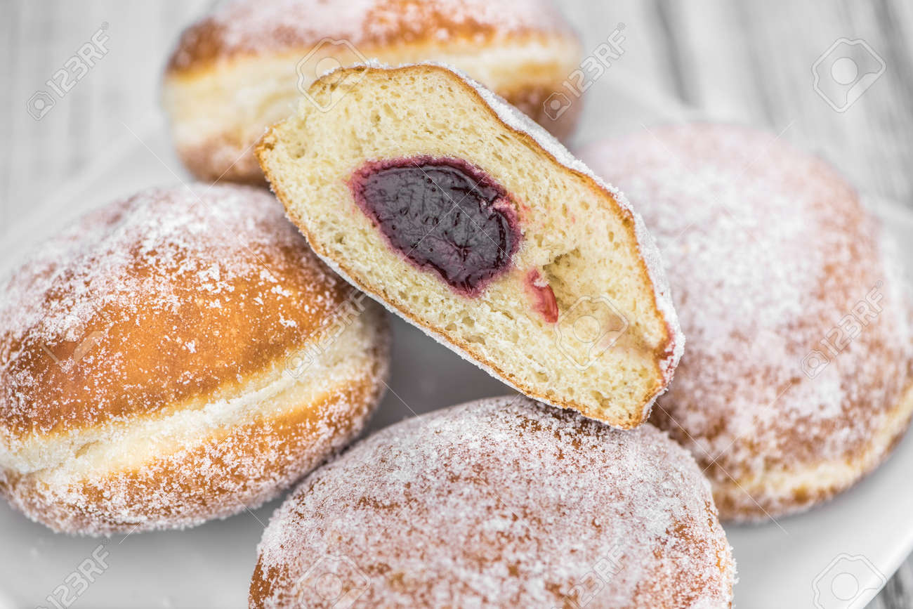 Portion of Berliner Doughnuts as detailed close-up shot; selective focus - 138250667