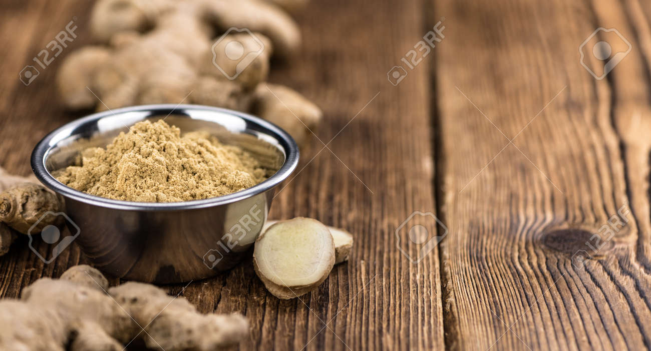 Some healthy Ginger Powder (selective focus; close-up shot) - 141941739
