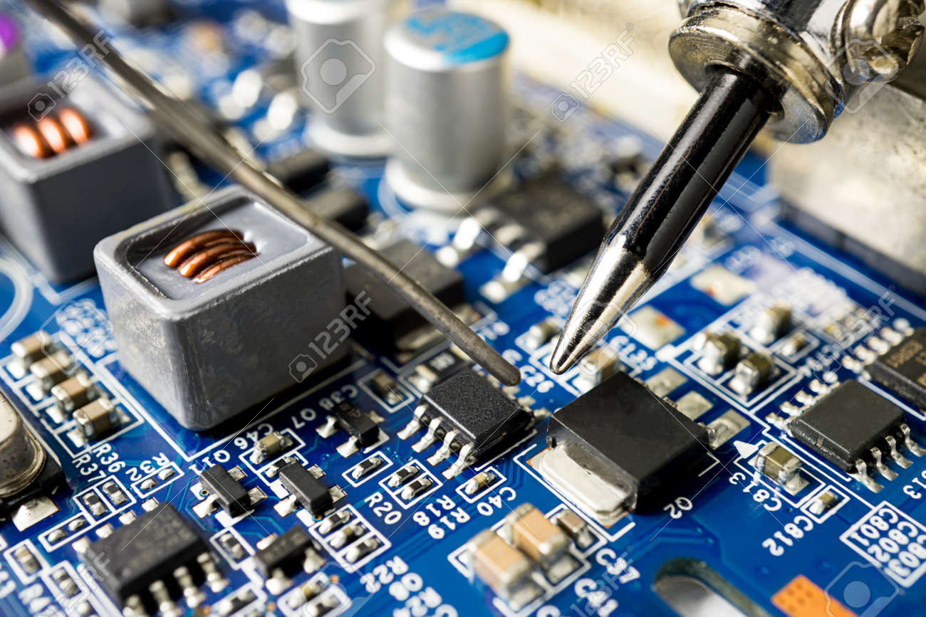 Repair Microchip With Soldering Iron And Tin Close Up Picture Stock Technician Repairing Electronic Circuit Board Photo 90010705