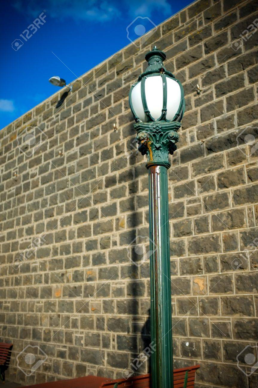 Old Style Street Lamp Post With Blue Stone Wall And Bright Blue ... for Stone Lamp Post  111bof