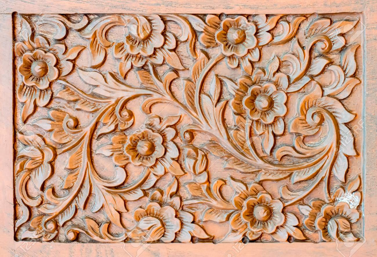 photo pattern of flower carved on wood