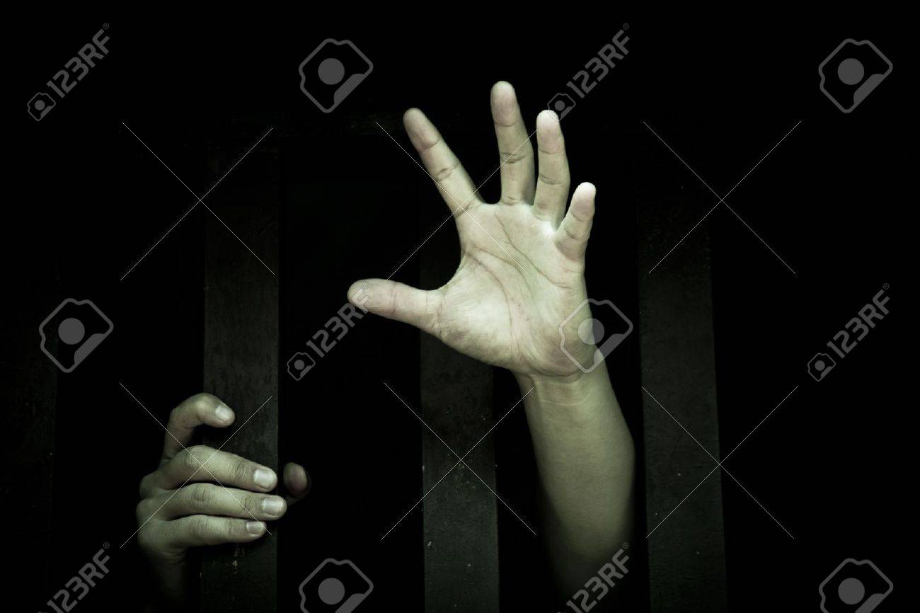 Human hand stretch out  from prison bars Stock Photo - 11238747